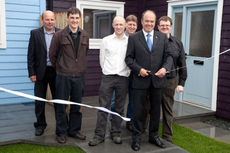 Cutting the ribbon on Quoys Phase Three on Friday: (from left) Drewie Manson - E & H Builders, Adrian Wishart - Richard Gibson Architects, Paul Leask - Hjaltland Housing Association, Bobby Elphinstone - E & H Builders, Jeff Goddard - Hjaltland Housing Association, Bryan Leask - Hjaltland Housing Association. Pic. Billy Fox
