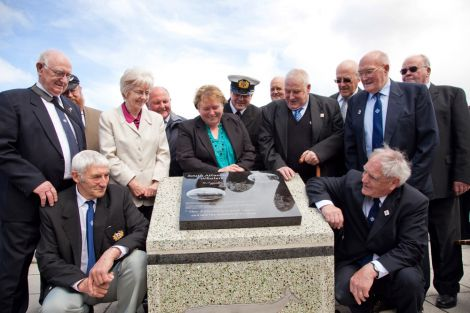 Recording the history of the whaling industry – members of the Shetland ex-Whalers Association, from left to right: Geordie Robertson, Davie Cooper, Gibbie Fraser (chairman), Laurena Fraser, Tony Jarmson, Pat Christie, Aubrey Jamieson (Fishermen's Mission), Alister Thomasaon, Mitchell Arthur, Jamie Smith, Willie Tait, Billy Craigie and John Winchester (vice-chairman) – Photo: Shetland News