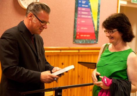 Film buff and Screenplay curator Mark Kermode handing a signed copy of his new book to fan Karen Fraser. Pic. Billy Fox