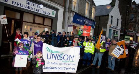 Union members march through Commercial Street on Wednesday morning - all photos: Billy Fox