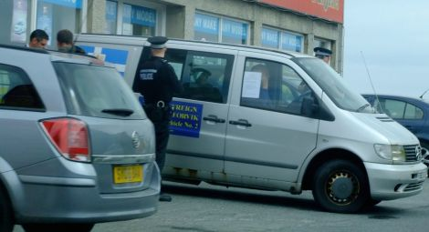 Stuart Hill being arrested in Lerwick on 5 July this year - Photos: Shetland News