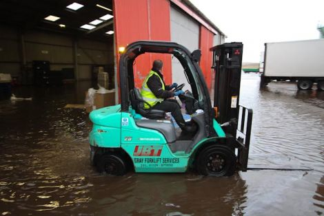 JBT transport company's warehouse at Gremista, Lerwick, was flooded by the overnight storm. Pic. David Paul