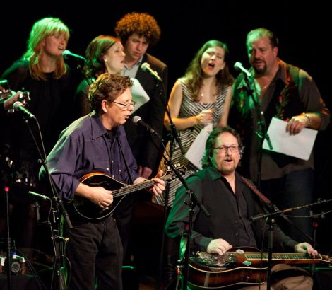 Tim O'Brien, Jerry Douglas with Eddi Reader, Karen Matheson, Declan O'Rourke, Ruth Moody and Raul Malo in back row, singing Woody Guthrie's, 'This Land is Your Land'.