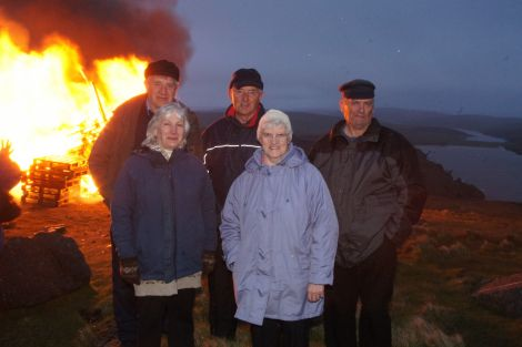 Five Unst residents who remember the Queen's coronation bonfire on top of Saxa Vord 59 years ago return for a repeat performance. From left: Willie Mouat, Minnie Mouat, Andrew Magnie Thomson, Edna Nisbet, Willie Henderson. Back then they were 6, 4, 16, 13 & 12. Pic. Ruth Grainger