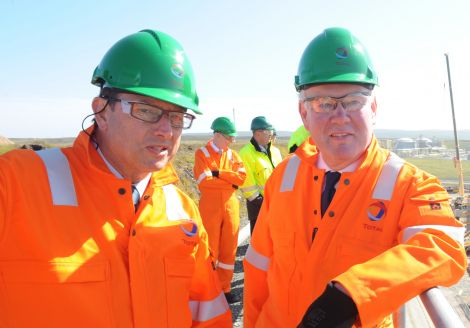 UK energy minister Charles Hendry (right) being shown around the Total gas plant construction site by the company's managing director Philippe Guys. Pic. Malcolm Younger