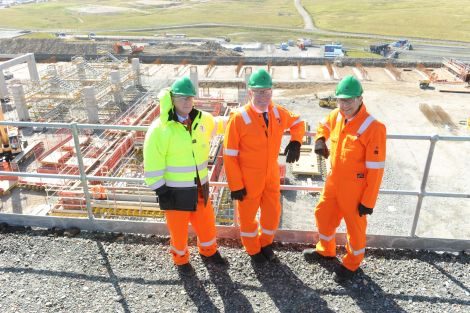 Total's senior vice president Patrice de Vivies (left) joins Mr Hendry and M Guys during Wednesday's tour. Pic. Malcolm Younger