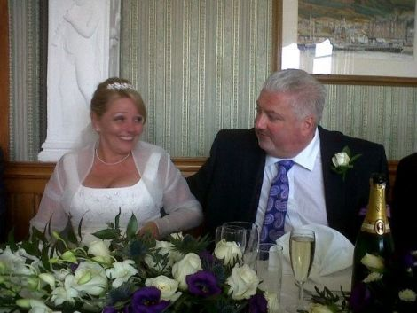 Former SIC chief executive Dave Clark and his wife Judith on their wedding day in April
