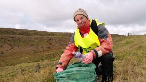 66 year old Cecilia James begins her marathon redd up. Pic. Shetland News