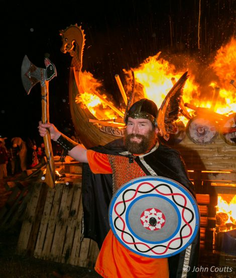 Uyeasound Guizer Jarl Colin Jamieson with his burning galley Uresvik - Photo: John Coutts