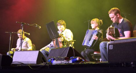 Sunday was a big night for 11 year old Niamh Wylie from Nesting who joined trad musician of the year Paddy Callaghan on stage with Adam Brown (left) and Danny Boyle (right) to perform her self-penned waltz. Photo Olivia Abbott