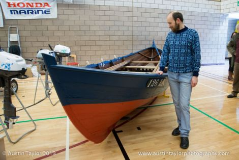 Shetland museum curator Dr Ian Tait admiring the cod boat Ann LK126, the rarest and second oldest Shetland boat in existence - Photo: Austin Taylor