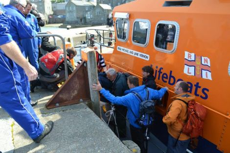Passengers being brought ashore from the Lerwick lifeboat after being rescued from the tour boat Alluvion on Friday afternoon. Photo BBC