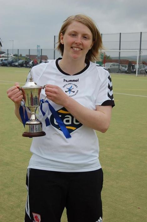 Shetland captain Toni Sudgwick earned the player of the match trophy for her sterling performance keeping the Orkney goal sheet so low. player of the match