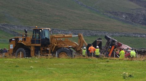 The concrete mixer is being bulldozed off the road - Photos: Ronnie Robertson