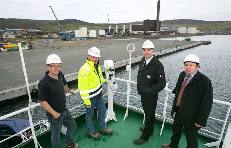 Handing over of Mair's Quay (left to right): Tulloch Developments directors Alistair Tulloch and George Smith; Lerwick Port Authority harbourmaster Captain Calum Grains, and Andy Sandison of Arch Henderson LLP.