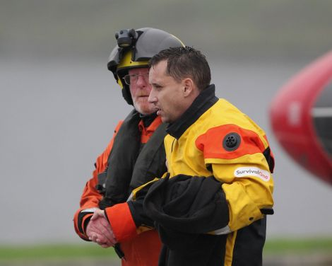 A passenger is guided off the rescue helicopter - Photo: Garry Sandison.