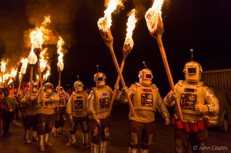 A squad of torch-wielding robots featured in the procession at Uyeasound Up-Helly-Aa. Photo: John Coutts