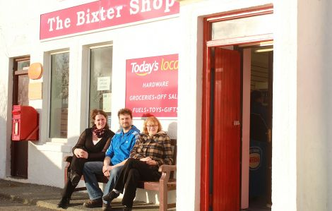 Kirsten and Steven Johnston, along with Steven's mother Margaret, take a well-earned breather outside the newly reopened Bixter Shop. Photo: Hans Marter/Shetnews.