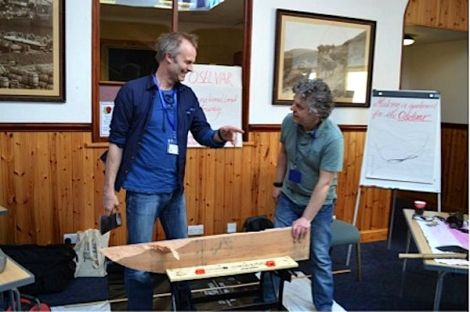 'Axe wielding Halgeirr Bjørnevik (left) demonstrating traditional boat building techniques to PhD student Marc Chivers.