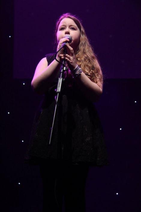 Twelve year old Ellie Arthur sung Bob Dylan's Feel my Love.