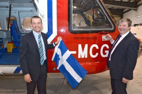Local MP Alistair Carmichael and chief pilot Jimmy Livitt unveiling Oscar Charlie. Photo Millgaet Media