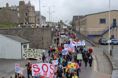 Demonstrators march through Lerwick last month to celebrate rural education and dissuade the SIC from their closure and other cost saving plans. Photo Shetnews