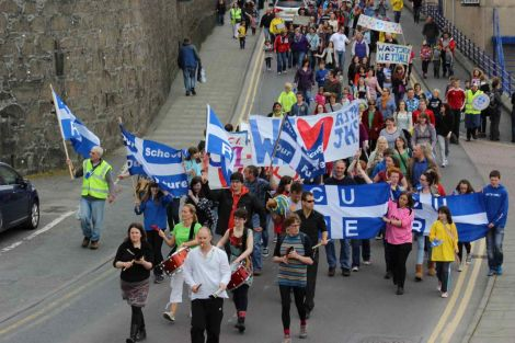 Protesters marched through Lerwick against proposed education cuts in June.