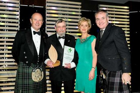 Nick Riddiford (second left) accepting the 2013 Scottish Marine Conservation Award from comedian Fred Macauley, TV presenter Sally Magnusson and Scottish environment secretary Richard Lochhead.