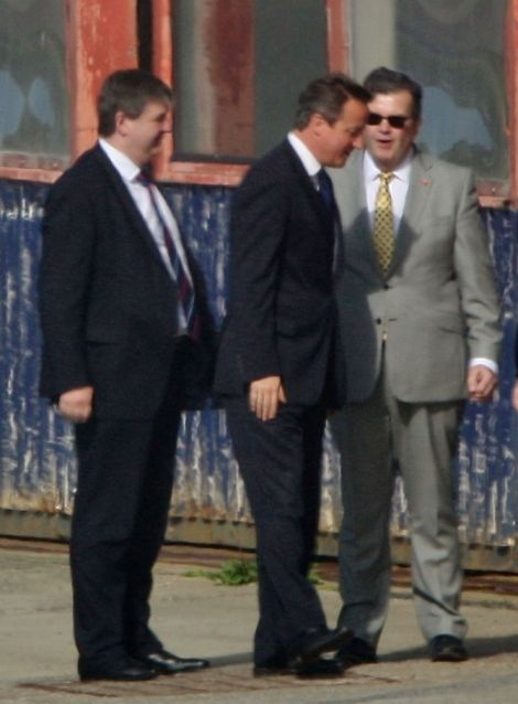 One of the first photos of David Cameron in Shetland taken shortly after his arrival at Sumburgh airport in the afternoon of 22 July. With him is Alistair Carmichael, the Scottish secretary and local MP - Photo: Ronnie Robertson