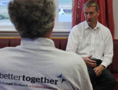 Tavish addresses Wednesday night's meeting at Hillswick public hall. Photo Shetnews