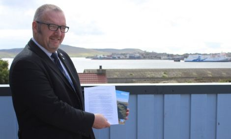 Shetland Islands Council leader Gary Robinson holds up the two pledges from the UK and Scottish governments for greater island powers following the independence referendum.