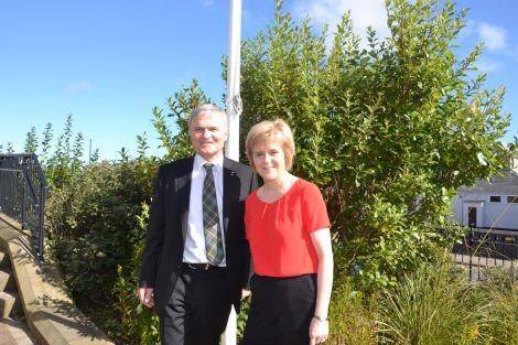 Deputy first minister Nicola Sturgeon, with SNP list MSP Mike Mackenzie, outside Islesburgh on Wednesday morning. Photo: Shetnews