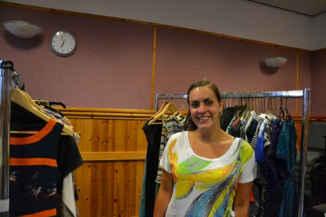 Annalie Irvine takes a break from organising racks of clothes for tomorrow's 'Sale for Syria' at Islesburgh. Photo: Shetnews