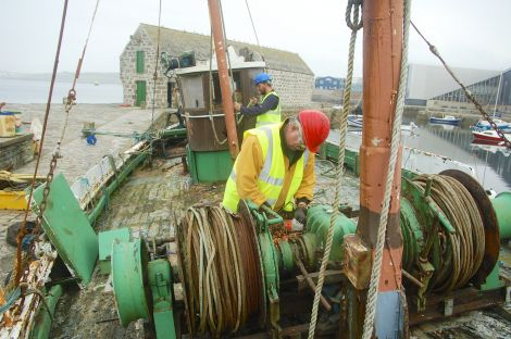Volunteers Peter Chroston and Tim Senften working on the Nil Desperandum - Photo: Shetland Amenity Trust