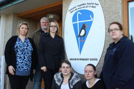 Angry members of the Urafirth parent council. From left: Clare Pottinger, Robin Sinclair, Pamela Ruddick, Liane Anderson, Charlene Johnston and Claire Herridge - Photo: Pete Bevington/Shetland News
