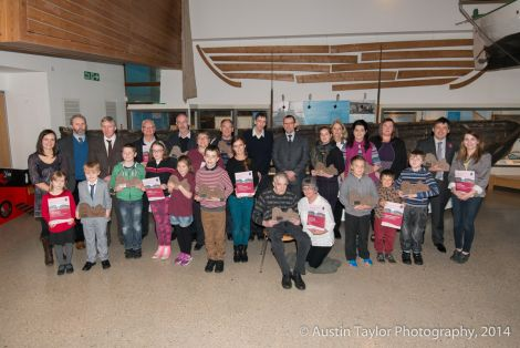 Iain Gulland (centre) with the winners of this year's Shetland Environmental Awards at the Shetland Museum and Archives on Wednesday - Photo: Austin Taylor