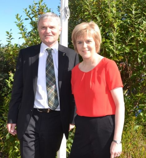 First Minister Nicola Sturgeon, pictured with MSP Mike Mackenzie in Shetland last summer, feels government attempts to tackle welfare problems and unemployment will remain hampered. Photo: Shetnews/Neil Riddell