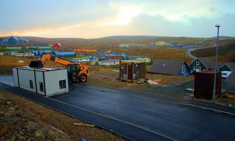 This portacabin at Staney Hill, in Lerwick, was unable to stand the strength of the wind on Monday afternoon. A JCB Loadall is keeping it from going any further - Photo: Nate Bryant