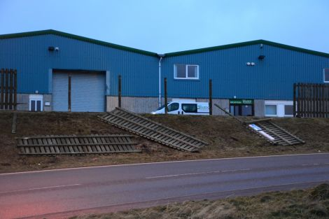 Fencing blown over outside Tulloch Developments' premises at Gremista in Lerwick. Photo: Mark Berry