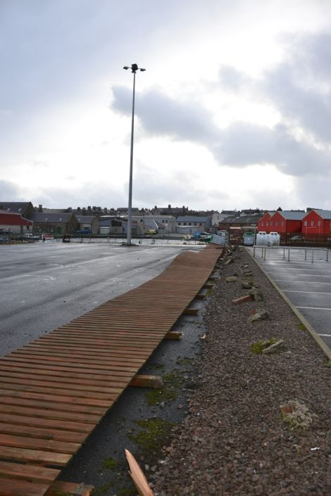 Flattened fencing at the Co-op supermarket's Lerwick car park. Photo: Shetnews