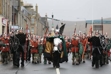 The Jarl's Squad, led by Neil Robertson, heading in over along Commercial Road in dreich conditions. Photo: Geoff Leask