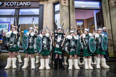 This year's junior squad of vikings, led by Guizer Jarl Lewis Harkness, in high spirits on Commercial Street. Photo: Craig Sim