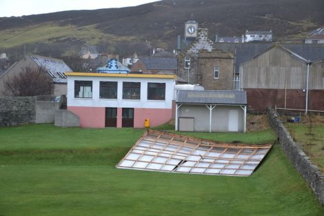 The roof of the old pavilion at Scalloway's Fraser Park has taken up residence on the football pitch. Photo: Shetnews