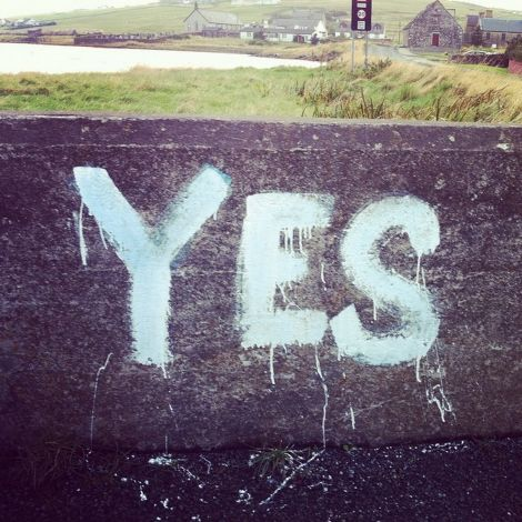 A bridge in Walls has borne a faded slogan reading 'Vote Liberal' for decades. Last summer a pro-indy campaigner added their own slogan. Photo: Floortje Robertson