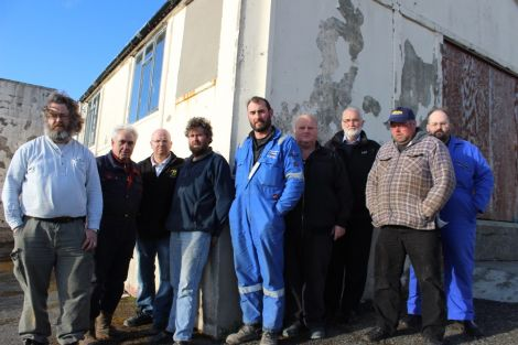 Just some of the Northmavine Up Helly Aa committee outside the galley shed they have spent thousands repairing doors, windows and roof. Photo Shetnews