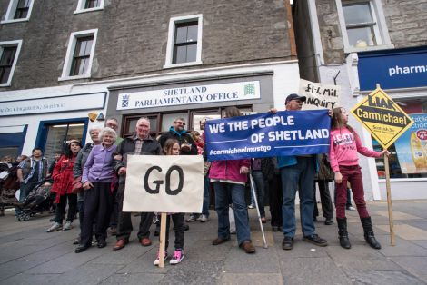 Protesters outside Alistair Carmichael's constituency office last Saturday. The protest is to be repeated this Saturday at 2pm.