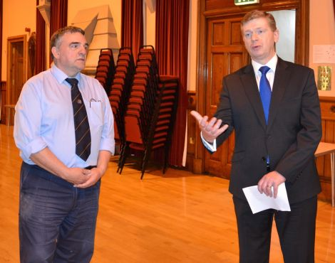 Town hall caretaker Billy Sandilands looks on as convener Malcolm Bell explains the extent of the damage. Photo: Shetnews