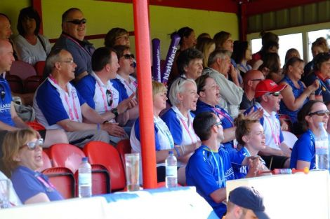 Team Shetland's travelling support in full voice during the footballers' match against the Falklands. Photo: Shetland Island Games Association