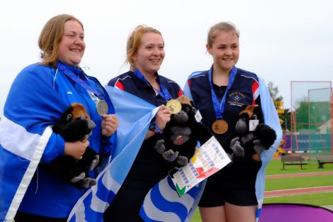 A proud moment for Elaine Park (left) as she receives her silver medal for the hammer throw. Photo courtesy of Shetland Island Games Association
