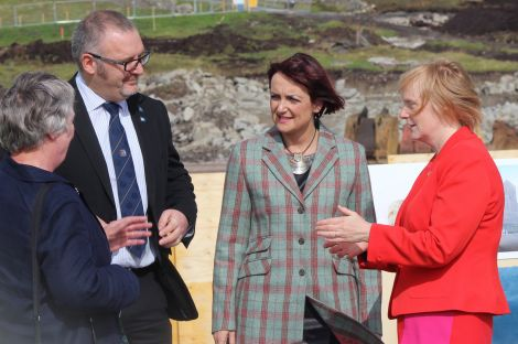 "Council leader Gary Robinson (here with education committee chairwoman Vaila Wishart (left), education secretary Angela Constance (centre) and SIC director of children's services) said he was ""very pleased"" that the council had managed to overcome all the obstacles and was finally building the new high school for Shetland."
